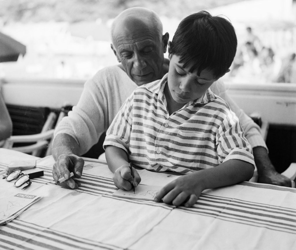 Pablo Picasso with his son Claude, August 21, 1955. Image courtesy Getty Images.