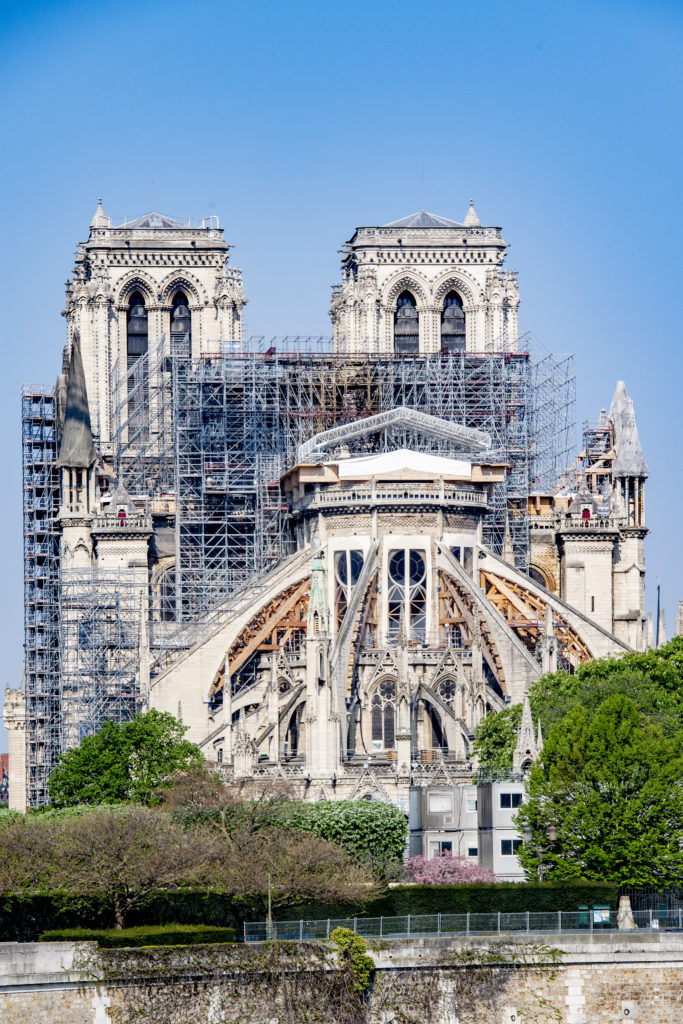 View of Notre Dame Cathedral in Paris as work paused in response to the coronavirus pandemic. Photo by Robin Utrecht/Echoes Wire/Barcroft Studios/Future Publishing/Getty Images.