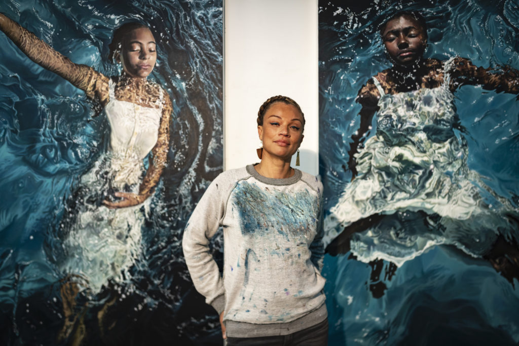 Rawles flanked by her two works 'Reflecting My Grace' (2019) at left and 'Radiating My Sovereignty' (2019) at right. Photo by Glen Wilson.