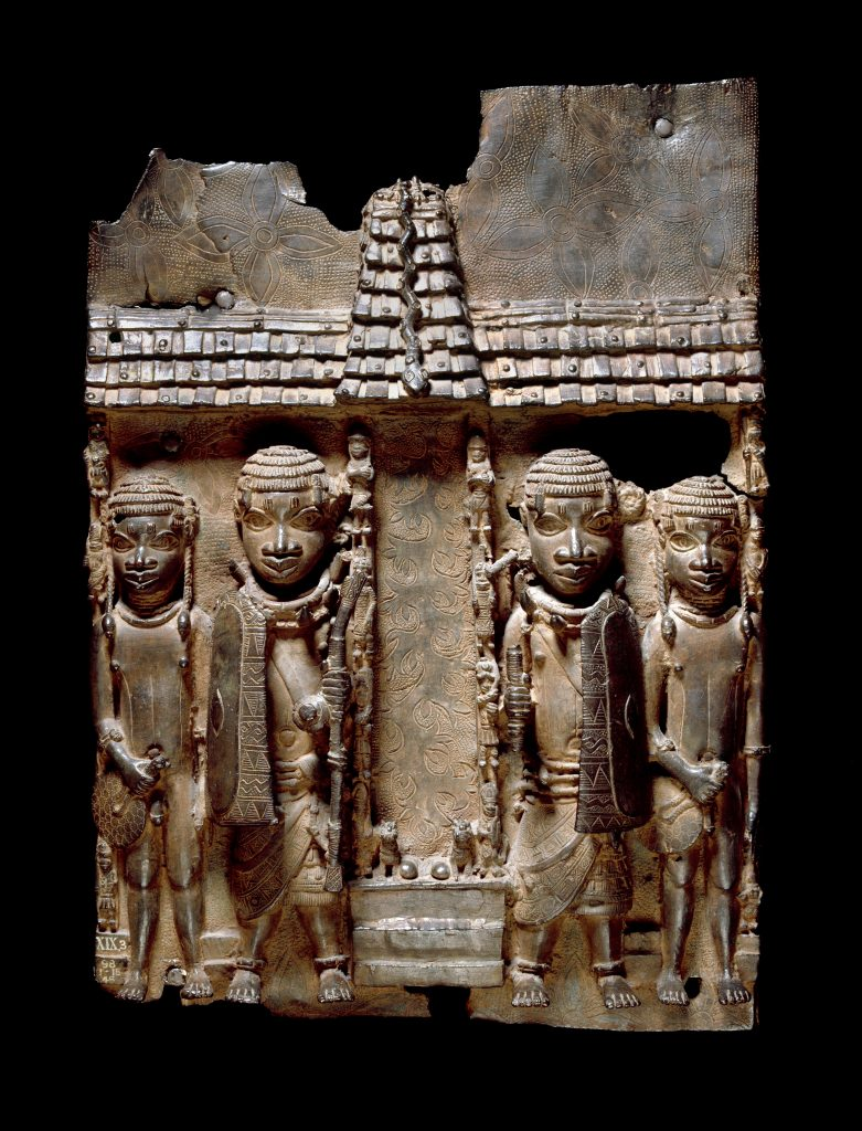 Benin brass plaque (16th- 17th century) showing Benin court officials flanking a palace entrance or altar. 2020 © Trustees of the British Museum.