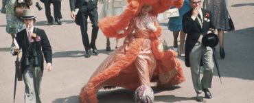 At Ascot Races, Gertrude Shilling appears in an apricot colored, feather trimmed outfit, which is completed by an enormous, matching, cartwheel hat, June 20, 1969. (Photo by Hulton Archive/Getty Images)