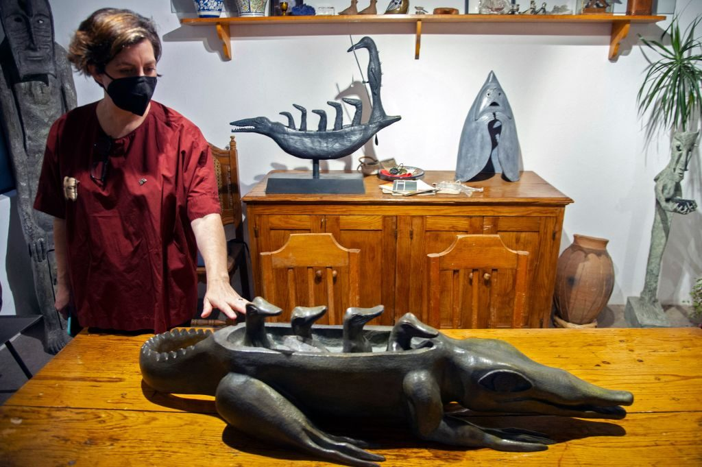 Alejandra Osorio, academic and cultural director of the diffusion coordination of the Metropolitan Autonomous University (UAM), shows a sculpture by British-Mexican artist Leonora Carrington at her house and studio in Mexico City, on May 24, 2021. Photo: Claudio Cruz/AFP via Getty Images.
