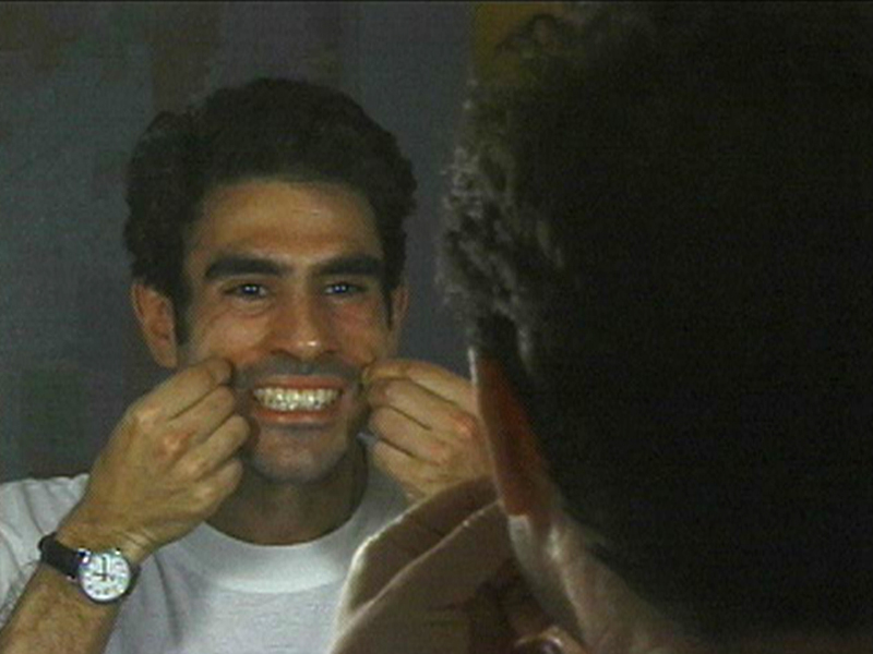 In several of his films, Gregg Bordowitz uses mirrors as a device to address both his audiences and himself. This still is from Habit (2001). Courtesy the artist and Video Data Bank at the School of the Art Institute of Chicago.