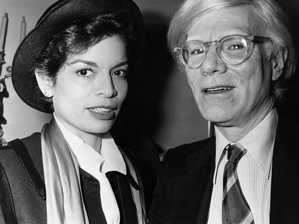 Bianca Jagger and Andy Warhol Photo by © Hulton-Deutsch Collection/CORBIS/Corbis via Getty Images.